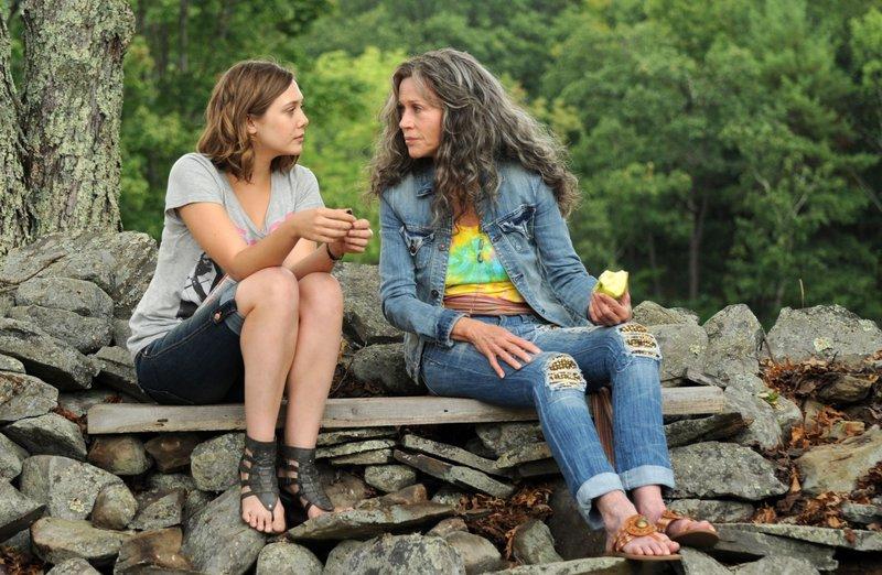 Elizabeth Olsen, left, plays an idealistic collegian and Jane Fonda her pot-smoking, '60s-generation grandmother in