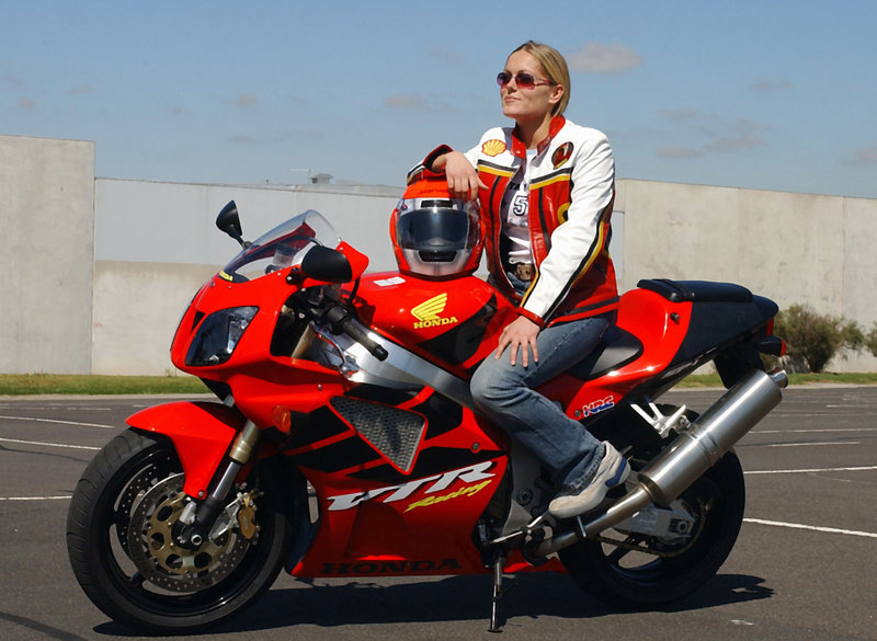 Katja Poensgen, a German motorcycle racer, rides a 250-cc Honda. Manufacturers report high demand from female riders looking to buy scaled-down, easy-to-control motorcycles for everyday use.
