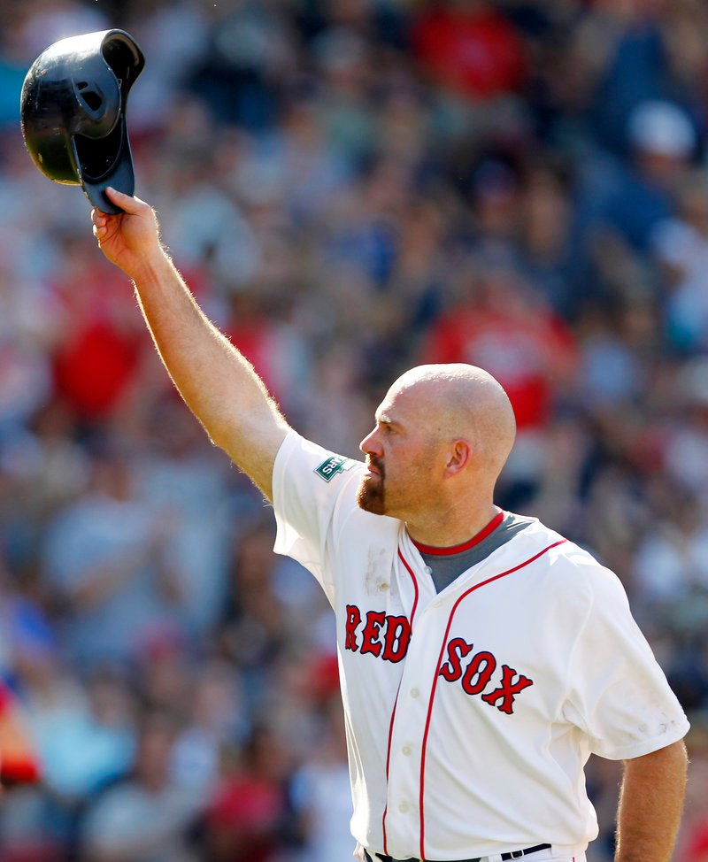 Kevin Youkilis acknowledges fans at Fenway Park as he leaves the field for the final time as a Red Sox. Youkilis got a standing ovation after leaving for a pinch runner in the seventh inning.