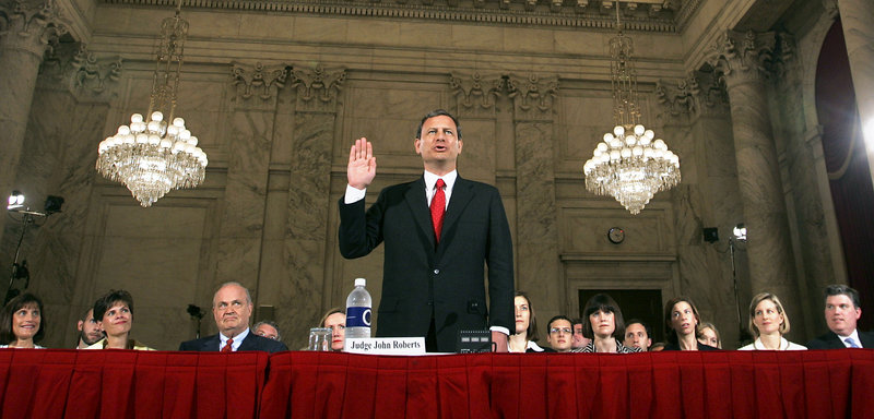 Judge John G. Roberts raises his right hand as he is sworn in before the Senate Judiciary Committe to testify on his confirmation to become the chief justice of the United States, in the Senate's Russell office building on Sept. 12, 2005.