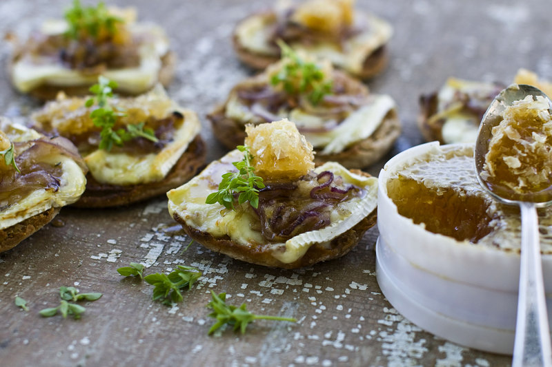 Honeycomb and brie combine deliciously on easy English muffin pizzas. Tubs of unbroken honeycomb increasingly are available at farmers markets and grocery stores, and its texture and taste enliven many dishes.