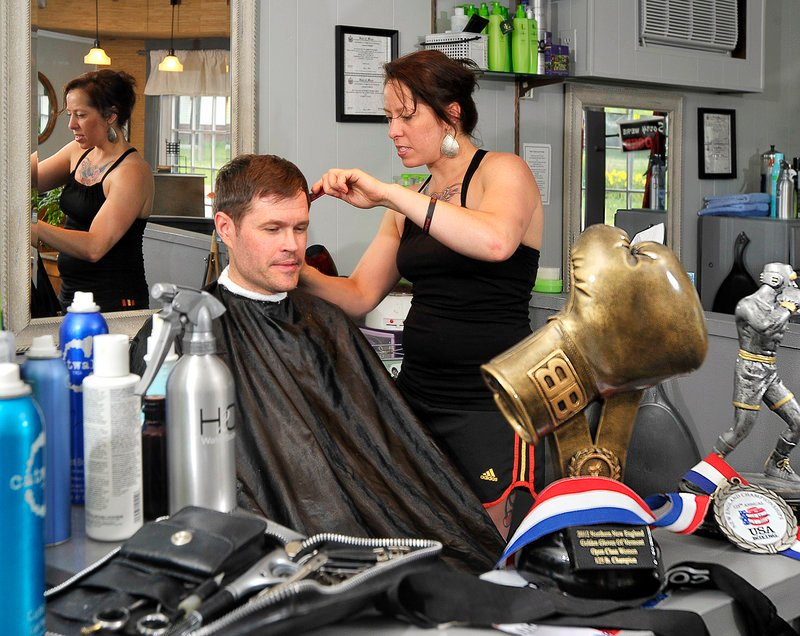 Liz Leddy is never far from boxing, even as she cuts the hair of Jeremy Young of Freeport at her salon in Portland. Leddy is a two-time national Golden Gloves champion.