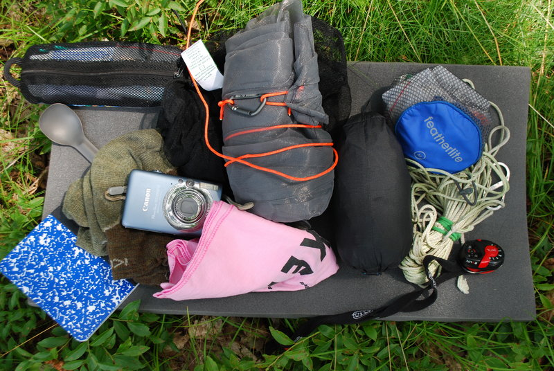 Ultra-light hikers carry little gear. Ryan Linn's backpack contains, clockwise from the top: an insect net, rain pants, first-aid pouch, bear rope, head lamp, bandanna, camera, journal, socks, spoon and toiletry pouch.