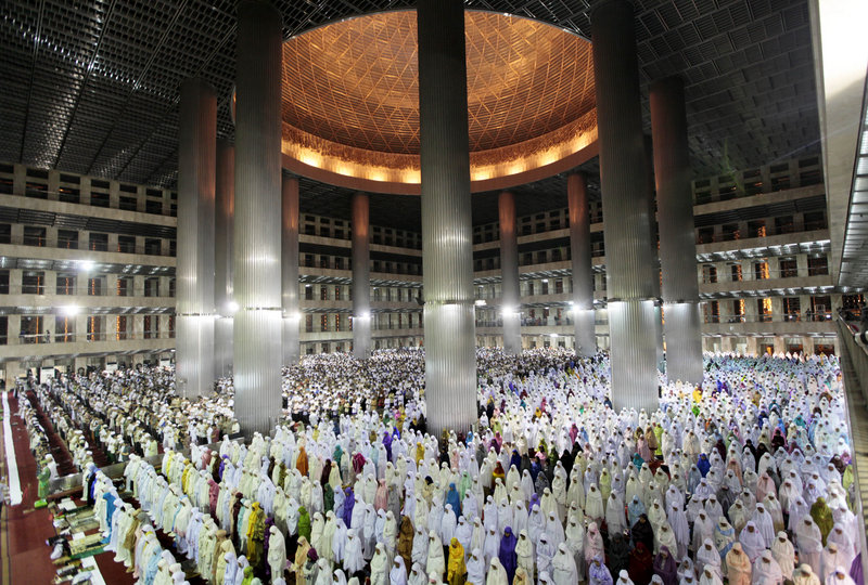 """Indonesian Muslims perform an evening prayer called """"tarawih,"""" marking the first eve of the holy fasting month of Ramadan at Istiqlal Mosque in Jakarta, Indonesia, on Friday."""