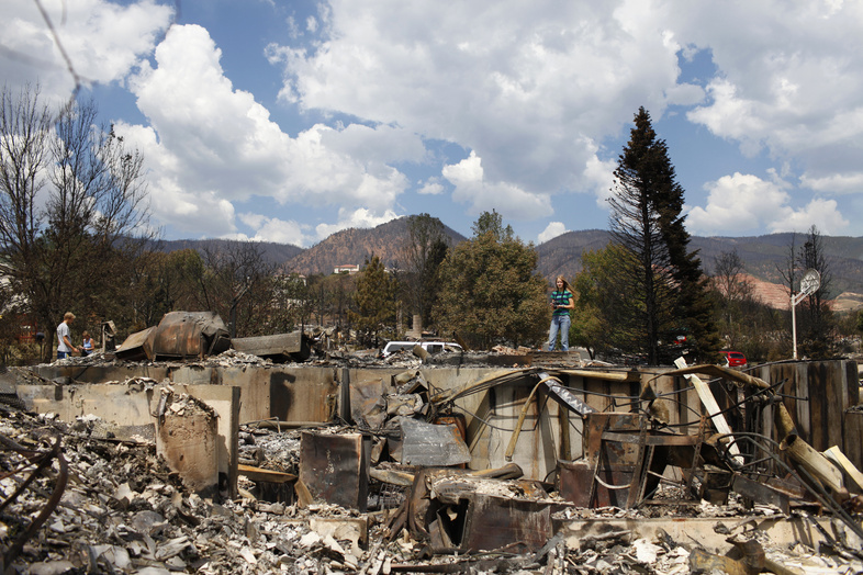 Krista Albers surveys what is left of her home Sunday in the Mountain Shadows subdivision of Colorado Springs, Colo., after the Waldo Canyon fire ravaged the neighborhood.