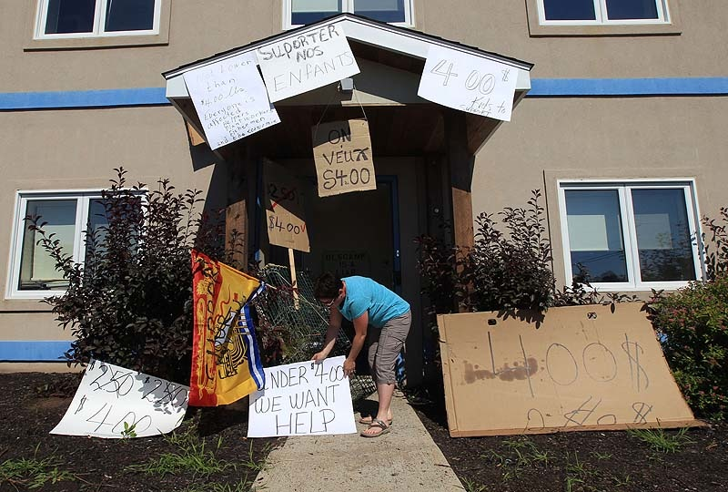 Protesters put signs up around the entrance to Ashfield's office. One says,