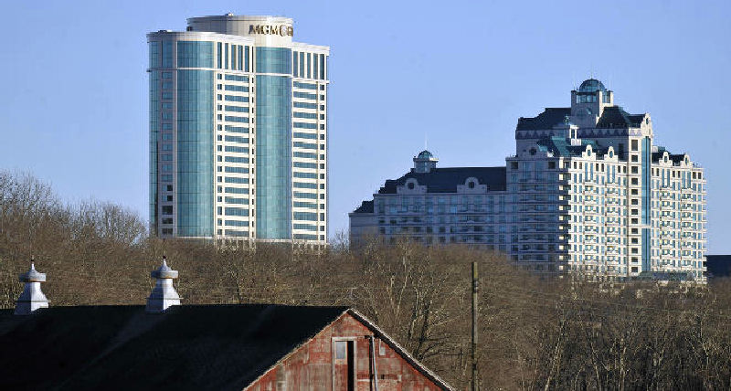 Foxwoods Resorts Casino and MGM Grand at Foxwoods buildings loom behind a barn in Mashantucket, Conn.
