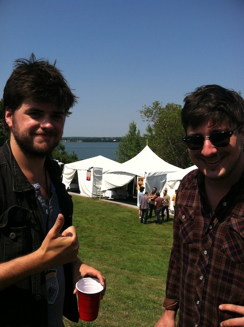 Winston Marshall and Marcus Mumford from Mumford & Sons hang out backstage on the Eastern Promenade at the