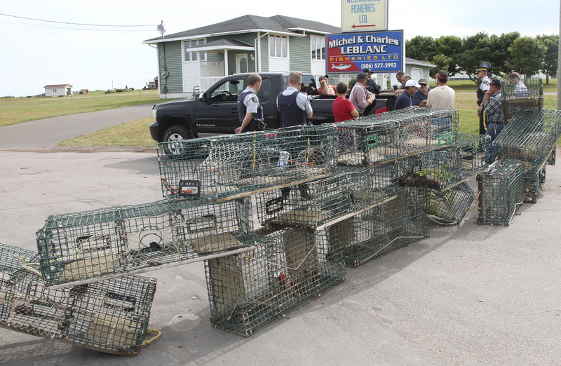 Fishermen in Cap-Pele, New Brunswick, blocked access to several processing plants Thursday to protest an influx of Maine lobster after being told they would be expected to provide fewer lobsters when their season opens next week.