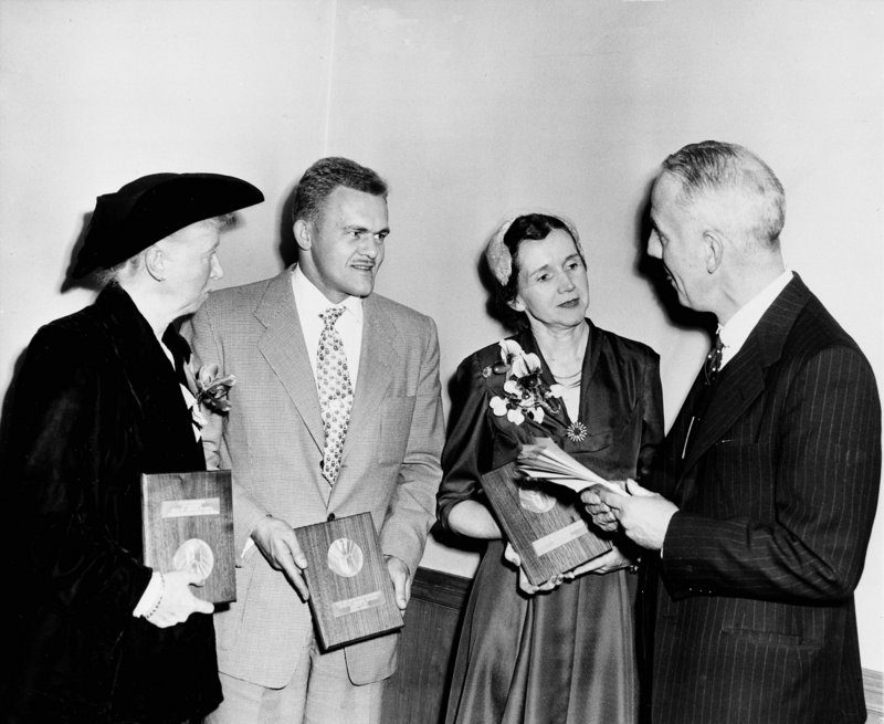 """National Book Award winners are, from left, Marianne Moore, James Jones and Rachel Carson, author of """"The Sea Around Us."""" At right is John Mason Brown, author and toastmaster at the ceremonies held in the Hotel Commodore in New York City in 1952."""