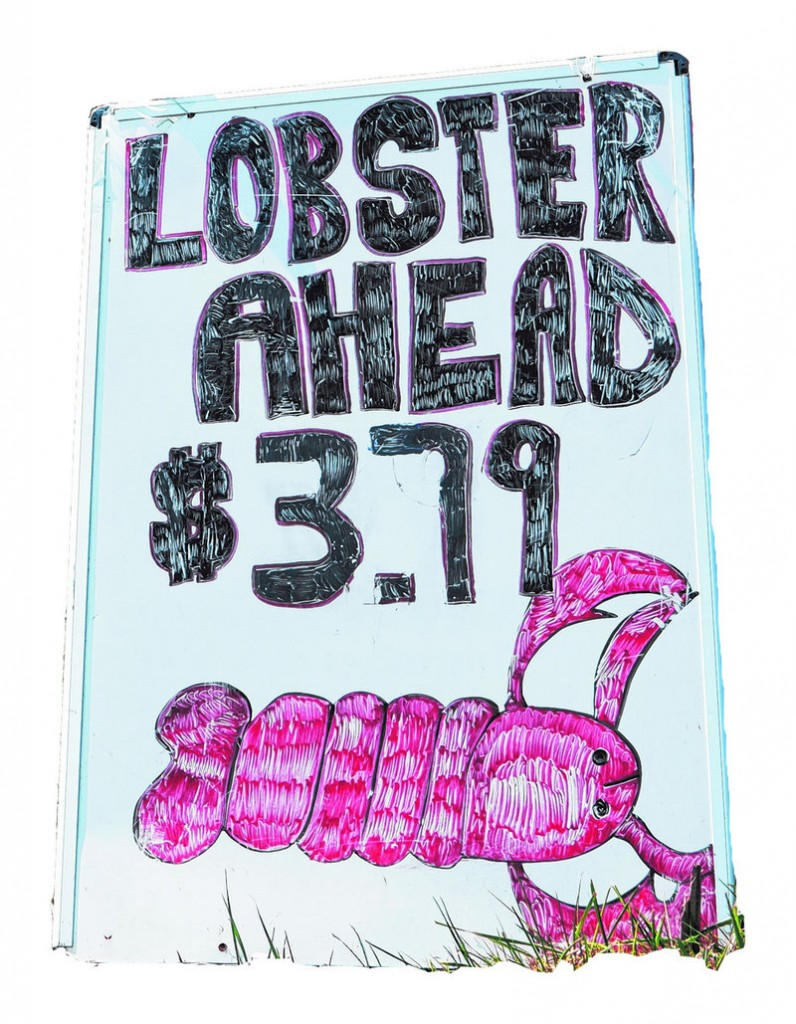 A sign on Commercial Street in Portland advertises the price per pound for lobster Thursday at Benny's Lobster.
