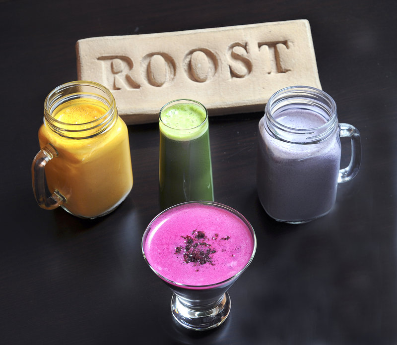 Beverages featured at Roost include, clockwise from left, Carrot Cake Smoothie, which tastes like its namesake with a mix of carrot juice, ginger, nutmeg and raisins; Regulator, a green juice concoction of kale, spinach, romaine lettuce, cucumber, celery, lemon and apple; AB&J Protein Smoothie (or almond butter & jelly), made with a mix of almond milk, almond butter, blueberries, flax seeds, hemp seeds and tahini; and Fancy-Full Juice Shaktini, served in a martini glass and made from beets, apples and blueberries garnished with a touch of beet pulp.