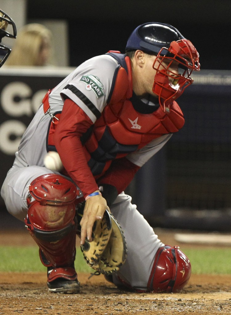 Red Sox catcher Ryan Lavarnway can't block a wild pitch by Josh Beckett, allowing Derek Jeter to score from third base.
