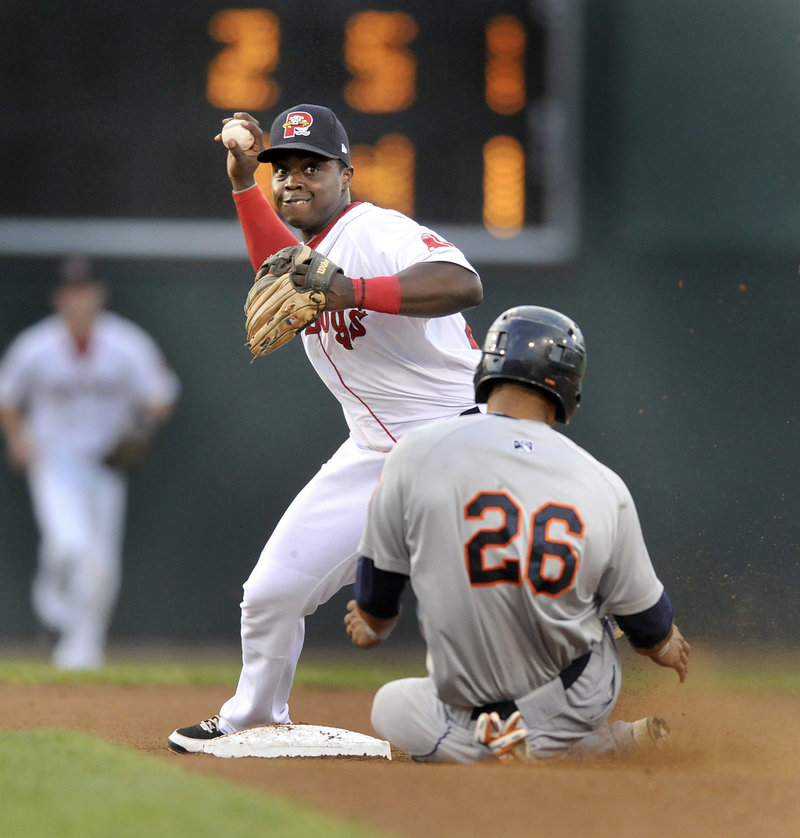 Second baseman Marquez Smith of the Portland Sea Dogs fires to first Saturday night after forcing Pedro Zapata of the Binghamton Mets in the fourth inning at Hadlock Field. The throw was late for the double play.