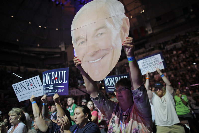 Mary White of Rathdrum, Idaho, shows her support for Rep. Ron Paul, R-Texas, at a rally at the University of South Florida Sun Dome on the sidelines of the Republican National Convention in Tampa, Fla., on Sunday.