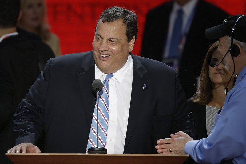 N.J. Gov. Chris Christie, the keynote speaker, looks over the podium during a sound check before his speech.