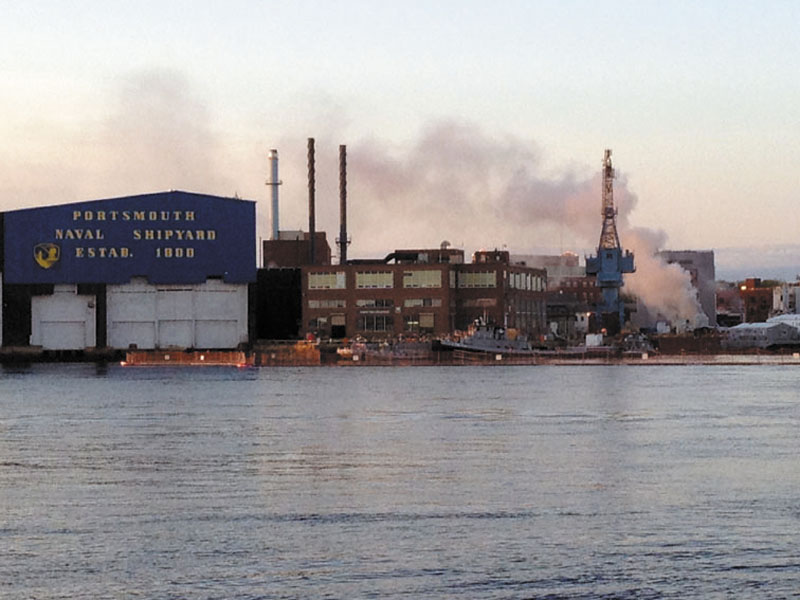 In this May 23, 2012 file photo, a fire burns on a nuclear submarine at the Portsmouth Naval Shipyard in Kittery, Maine. (AP Photo/WMUR, Jean Mackin, File)