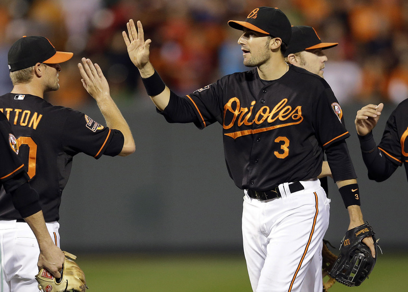 The Orioles' Ryan Flaherty (3) high-fives teammates after a game against the Red Sox in Baltimore on Friday. Flaherty hit a grand slam and a run-scoring double in the Orioles' 9-1 victory.