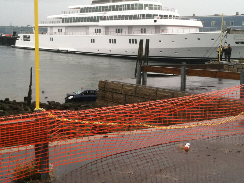 Site of a crash that left a car in the harbor today in Portland at the base of India Street.