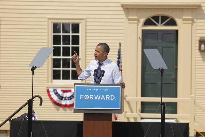 President Barack Obama addresses a crowd of supporters during a campaign stop with first lady Michelle Obama, Vice President Joe Biden and Jill Biden in Portsmouth, N.H., on Friday.