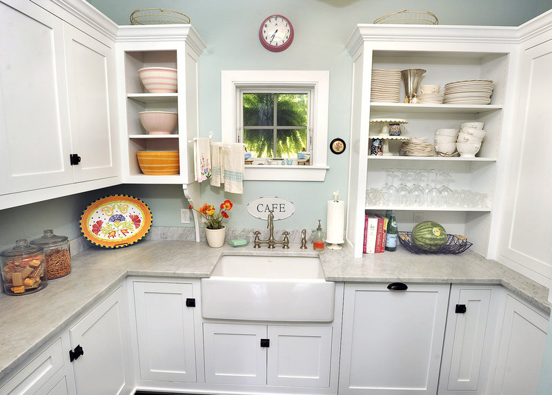 Christine Laughlin's kitchen, top, was included on this year's tour because it's a good example of the all-white style that's popular now. Angela Meyer's kitchen, below, combines granite counter tops and other custom-made materials with modestly priced IKEA cabinetry.