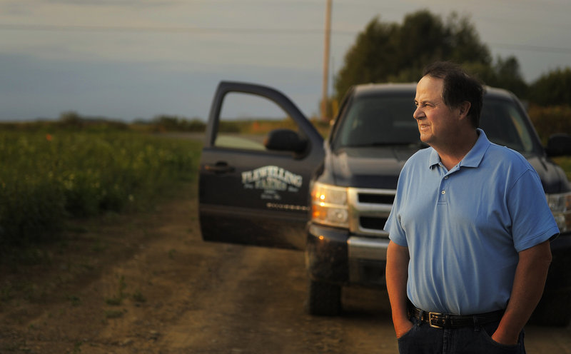 """Bruce Flewelling says last year's rain caused some potatoes to rot in the warehouses, while this year's dry weather mean the warehouses won't be full. """"It's a one-two punch,"""" he said."""