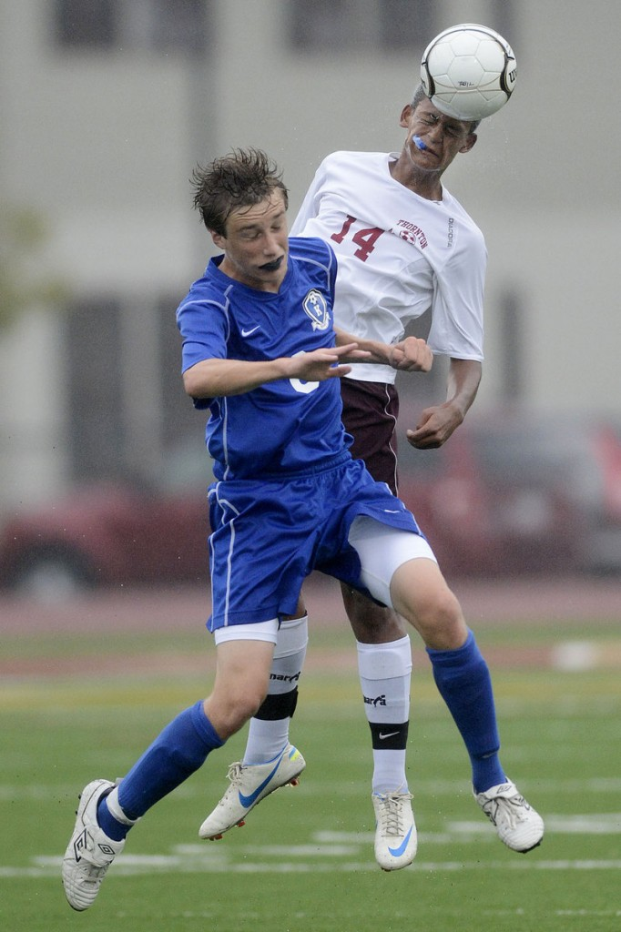 Ryan Keefe of Kennebunk, foreground, and Darius Nytacyo of Thornton Academy attempt to head the ball Tuesday during Kennebunk's 2-0 victory at Saco.