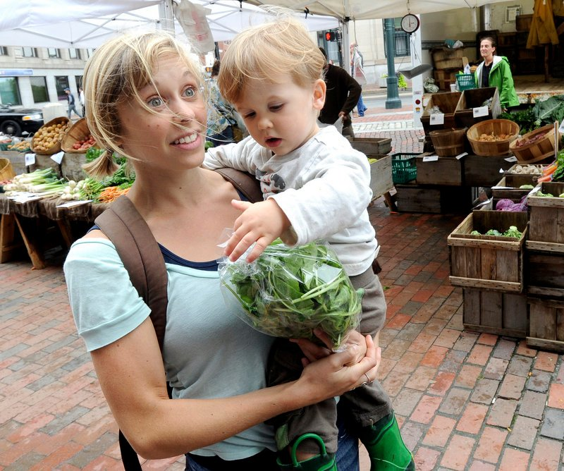 Anna Korsen of Portland, shopping with her 2-year-old son, Arlo Korsen-Cayer, says,