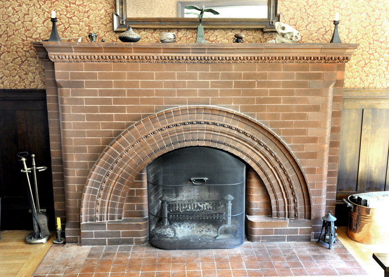 """The fireplace in the living room with its """"egg and dart"""" detailing."""