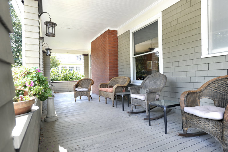 The front porch of the 1914 Arts & Crafts house near Back Cove in Portland is 44 feet long, 10 feet wide, and supported by stately columns.