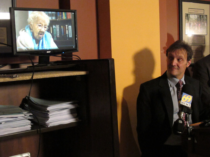 Viviette Applewhite, 93, a plaintiff in a lawsuit against Pennsylvania's voter identification law, speaks in a video played at a news conference in May in Harrisburg, as attorney Witold Walczak of the American Civil Liberties Union listens. The case is headed for the state supreme court.