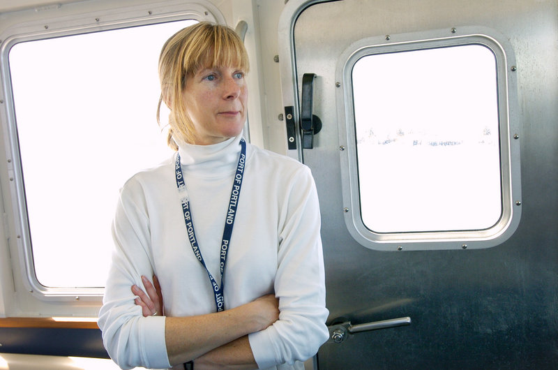 In this 2005 file photo, Capt. Susan Clark rides back into Portland after piloting an oil tanker out of Portland Harbor. Clark, the harbor's first female pilot, died Thursday at 48 after a brief battle with cancer.