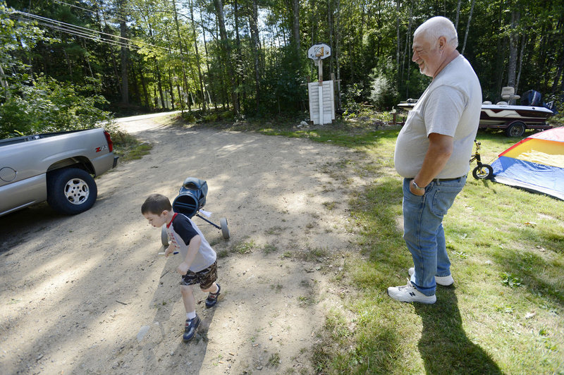Richard Dyer of Lebanon watches his grandson Joey Dyer, 3, as he plays in the yard Tuesday. Thirty farm-raised pheasants died recently in Lebanon from Eastern equine encephalitis. It's rare in humans, and only a few cases are reported in the U.S. annually.