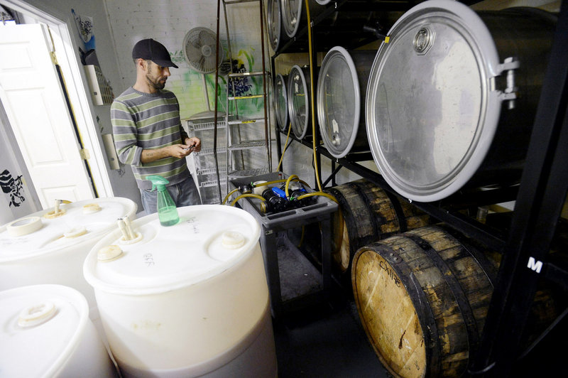 Eli Cayer of Urban Farm Fermentory transfers fresh cider from 60-gallon containers to fermentation vessels. Cayer produces three hard ciders at Urban Farm – Dry Cidah, Dry Hopped Cidah and Baby Jimmy.