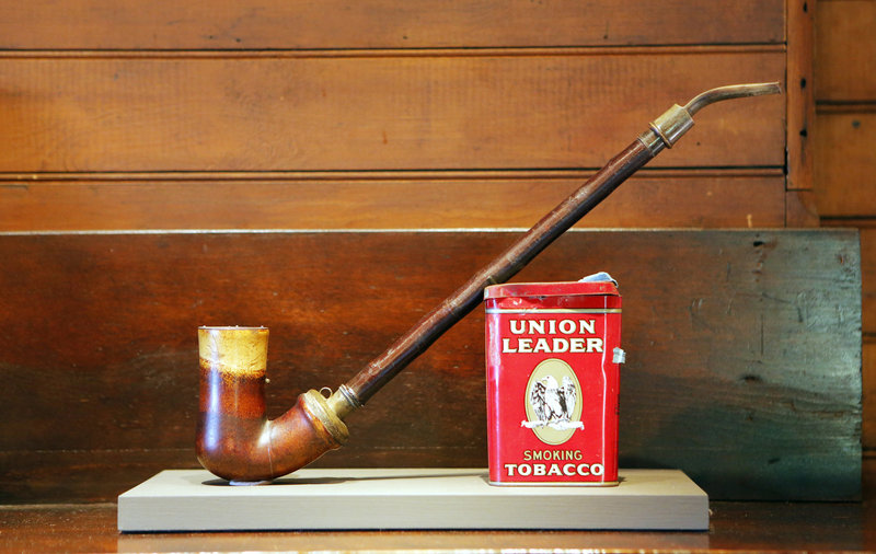 Homer's studio resonates with echoes of the artist's presence, including this pipe and a tin of tobacco, which rest atop the mantel in the parlor.