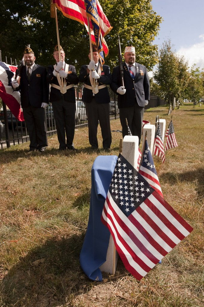 Members of the Deering Memorial Post 6859 Veterans of Foreign Wars honor Richard Hill, an African-American veteran of the War of 1812, at Eastern Cemetery in Portland on Saturday.