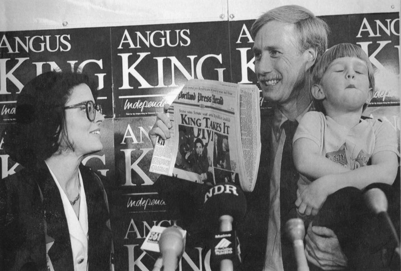 NOV. 9, 1994: Accompanied by his wife, Mary Herman, left, and their son Benjamin, then 4, Angus King holds up a copy of the Portland Press Herald on the day after he was elected governor.