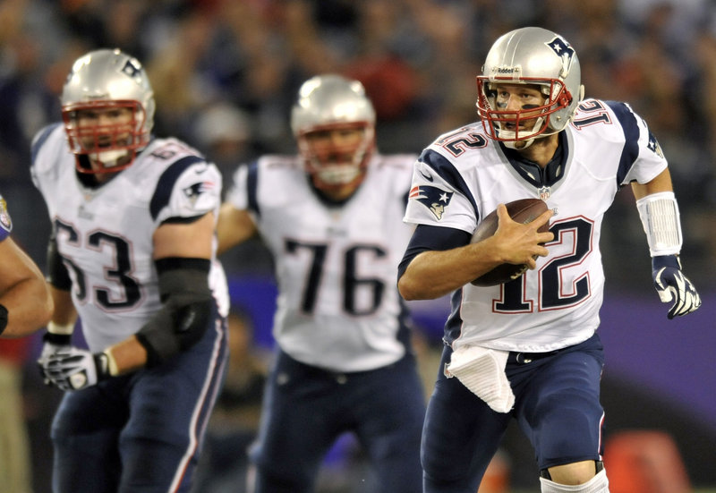 Tom Brady scrambles out of the pocket as linemen Dan Connolly, left, and Sebastian Vollmer look on. Brady threw for 335 yards, but the Patriots lost, 31-30.