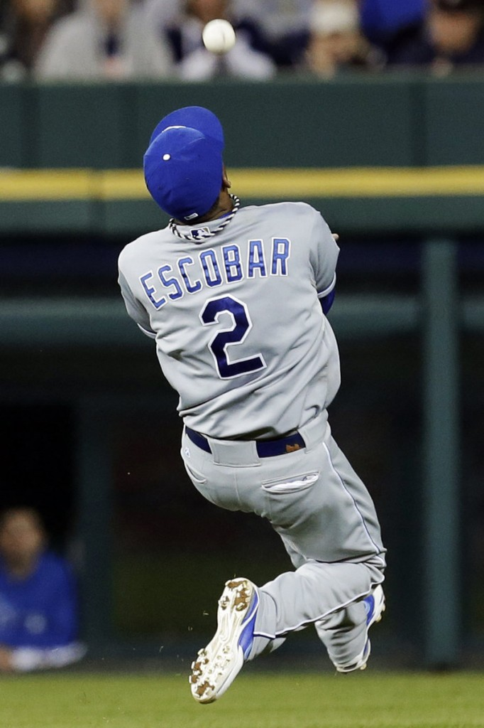 Royals shortstop Alcides Escobar makes a running over-the-shoulder catch in the fifth inning of a 5-4 loss to the Tigers Wednesday at Detroit.