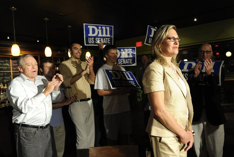 Cynthia Dill, seen June 12, when she won the Democratic U.S. Senate primary, earned her place on the November ballot and has no reason to step aside, her campaign says.