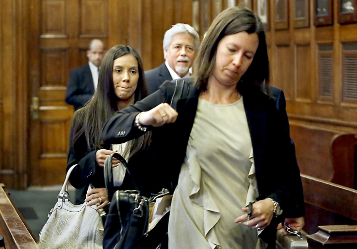Alexis Wright follows her lawyer, Sarah Churchill, out of the courtroom, as Mark Strong Sr. talks with his lawyer after their arraignments at the Cumberland County Courthouse in Portland on Tuesday.