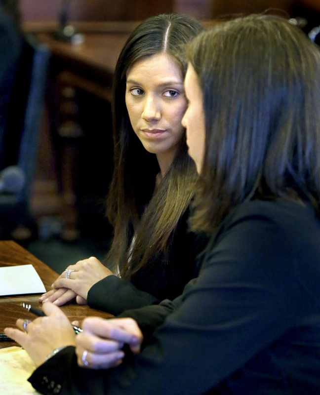 Alexis Wright, left, with her lawyer, Sarah Churchill, during Wright's arraignment Oct. 10 at the Cumberland County Courthouse in Portland.