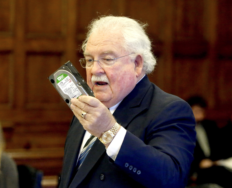 Daniel Lilley, attorney for Mark Strong Sr., holds a hard drive that he received as part of the discovery process in Tuesday's proceedings. He estimated that he has only a quarter of the data in the alleged prostitution case that prosecutors have.