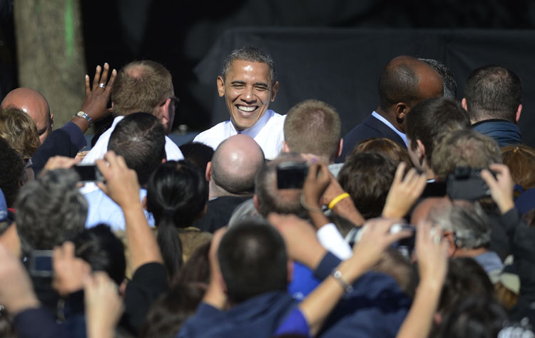 President Barack Obama shakes hands with supporters as he leaves Veterans Memorial Park in Manchester, N.H., Thursday.