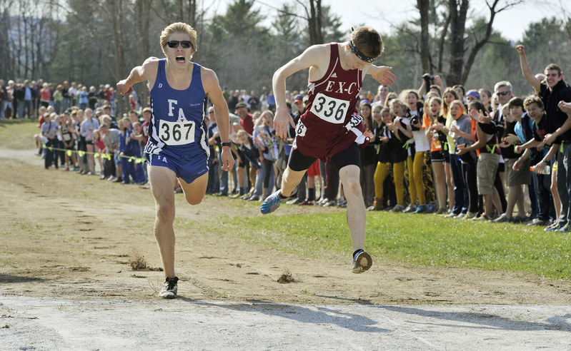 Dan Curts, right, of Ellsworth just beats out Silas Eastman of Fryeburg Academy in the Class B boys' race, which was the closest of the day.