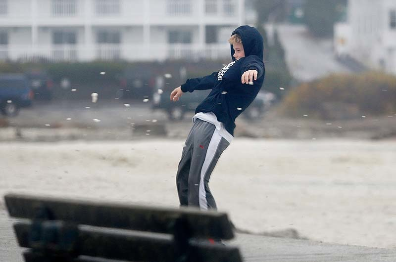 Thomas Beecher, 13, of York is held up by the wind at Short Sands Beach, Monday, Oct. 29, 2012, as the area began to see effects of Hurricane Sandy.