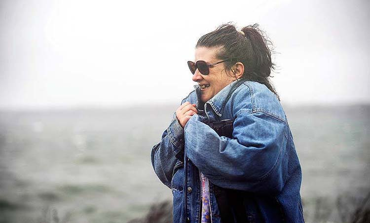Hilda Anderson of Springvale had enough of Hurricane Sandy and headed back to her car after watching the storm crash onto East End Beach on Monday.