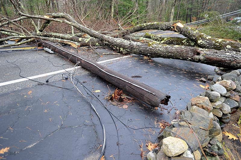 This utility pole was snapped off when a tree fell across Methodist Road during superstorm Sandy. Photo taken on Tuesday, October 30. 2012.