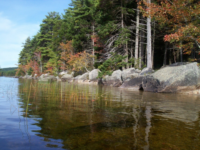 Large boulders line the shore in many places at Donnell Pond – located about 12 miles east of Ellsworth via Route 1 in one of Maine's Public Reserved Lands – and some boulders are perched right in the water.
