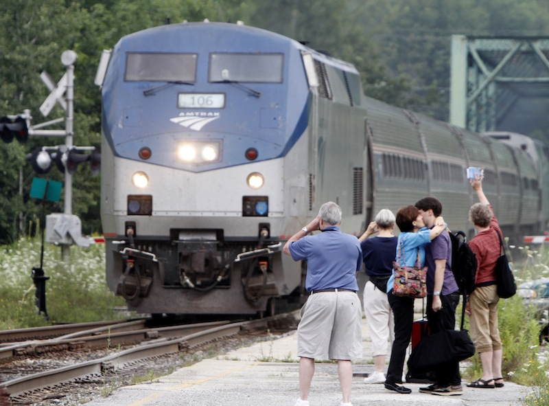 In this Aug. 3, 2010, file photo, people wait as the Amtrak Vermonter arrives in Montpelier, Vt. Amtrak has set new ridership records. The national high-speed rail operator says its trains carried more than 31 million passengers in the fiscal year ending Sept. 30. That marks the highest annual ridership total since Amtrak started operations in 1971. Records were set on Ethan Allen ridership between New York and Rutland, Vt., up 10 percent to more than 54,000 and the Vermonter from Washington to St. Albans, Vt., had 5.5 percent more passengers at 82,000.(AP Photo/Toby Talbot, File)